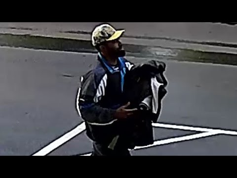 WEB EXTRA: Surveillance Video Of Suspect Wanted For Stealing Car With Child In The Backseat
