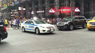 NYPD CRUISER RESPONDING WITH BIT OF RUMBLER ON WEST 42ND STREET IN TIMES SQUARE, MANHATTAN, NYC.