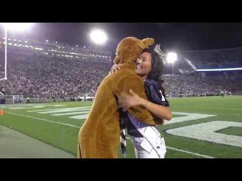 Miss Pennsylvania dances with the Nittany Lion during Penn State game