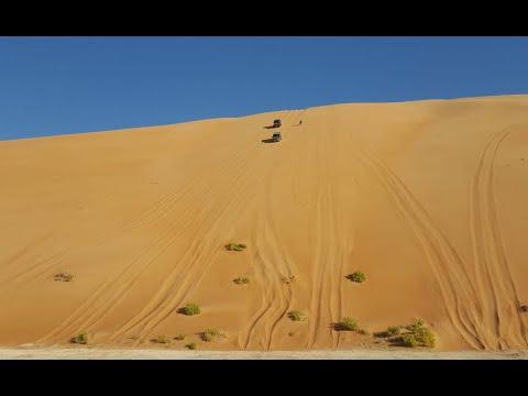 star dunes desert coming down from a dune of soft sand, dubai desert safari dangerous drive