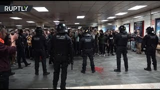 Protest turns violent as Catalan students occupy subway station in Barcelona