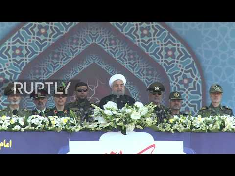 Iran: Rouhani vows to defend Iran amid huge military parade