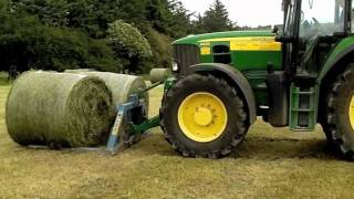 John Deere drawing baled silage