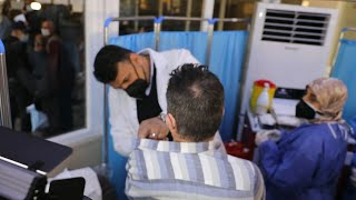 GLOBALink | Iraq starts vaccination of health workers with China-donated vaccines
