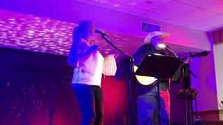 "William MacLeod and Evelyn MacRae doing a cover version of ""Country Roads"""