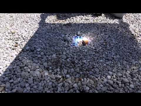 Solar death ray (Fresnel lens) melting and popping rocks