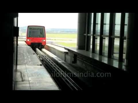 Kuala Lumpur Airport Monorail Express arrives at its station