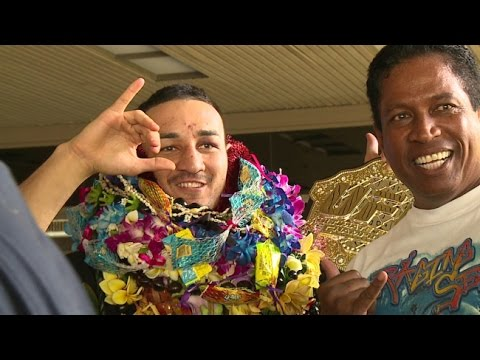 Fans gather at Honolulu airport to welcome UFC's Holloway, Medeiros