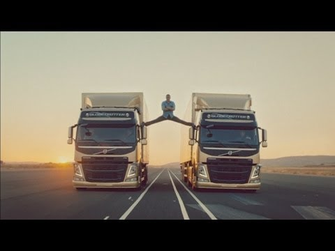 Jean-Claude Van Damme performs splits between two moving Volvo trucks