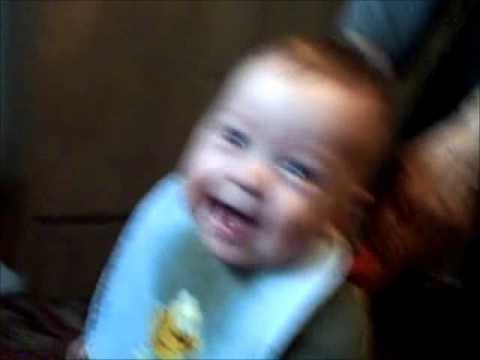 Baby boy laughing hysterically