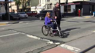 Electric Wheel for WheelChairs  Turns your wheelchair into an electric scooter