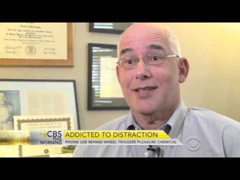 Distracted drivers feel addicted to behind the wheel cellphone use, AT&T survey finds   CBS News