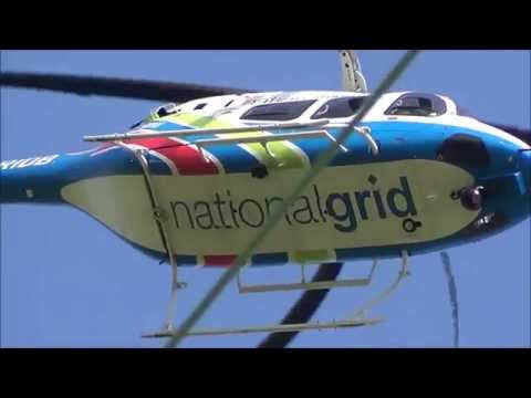 National grid helicopter, surveying close to the power lines