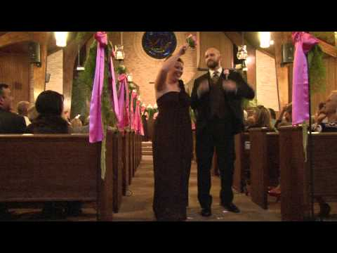 Wedding Party Dances Out Of Ceremony