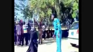 Woman getting whipped in the streets of Sudan. (Subtitle) HD1080p.