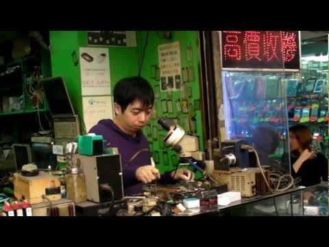 Hong Kong. Phone Repair Service in the Street. Sham Shui Po