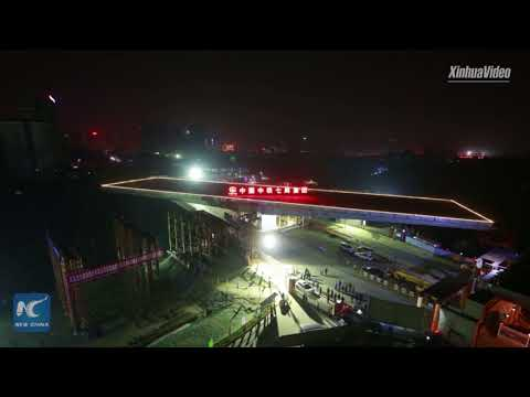 Swiveling bridge turns 100 degrees in 100 minutes, in Wuhan,