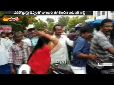 Woman Slapped Eve Teaser With Slipper in Guntur District