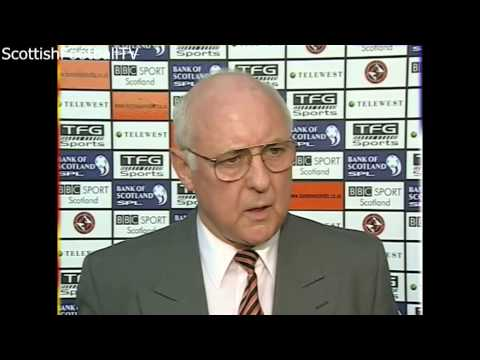 Jim McLean punches BBC reporter John Barnes