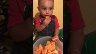 Baby won't give Titi some melon