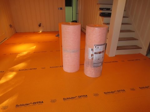 How to tile a large basement floor  Part 1 Installing Schluter Ditra