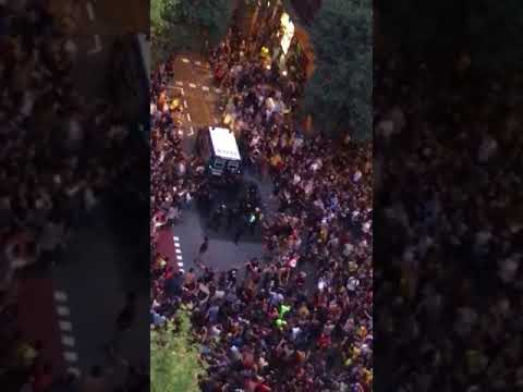 Spanish Police fire shots as they move away from CUP HQ in Barcelona