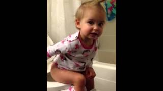 Abby is potty training. Daddy is not ready.