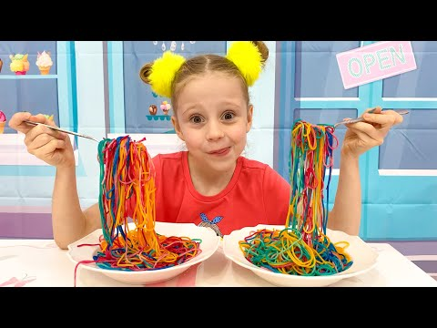 Nastya and Papa are preparing colored noodles