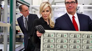 Treasury Secretary Mnuchin and his wife mocked for posing with a sheet of money