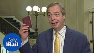 Nigel Farage celebrates the new, blue, post-Brexit passport - Daily Mail