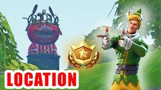 LOCATION - SEARCH BETWEEN A GIANT ROCK MAN A CROWNED TOMATO AND AN ENCIRCLED TREE - FORTNITE