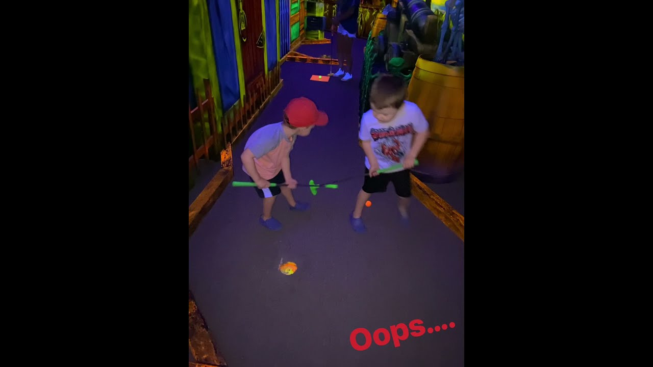 Wyatt and Jack miniature glow golfing!