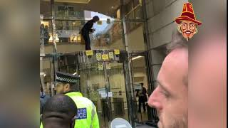 Extinction Rebellion Smash at DfT Windows With Hammer
