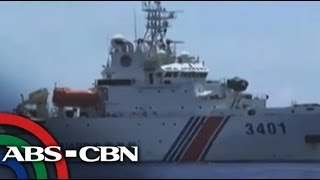 Philippine ship plays cat-and-mouse with Chinese vessels