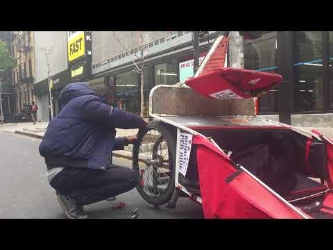 repairing a pedicab, Theater District, New York (November 2017)