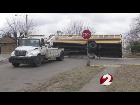 School bus crash raising questions about lack of stop signs, speed bumps