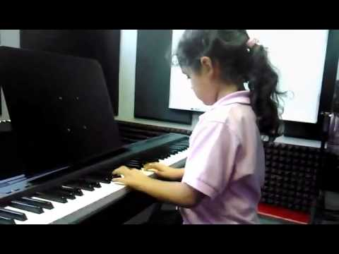 "One of my students, Emely playing ""Santa Claus is coming to town"" Just in time for Christmas!"