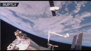 Full contact! SpaceX Dragon ship docks with Intl Space Station