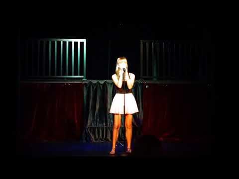 Abi Muir performing 'Firework' at Cairns Dinner Theatre