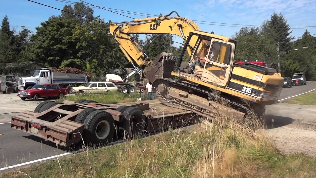 Side Loading Cat 315 Excavator Onto Peerless Lowboy - YouTube