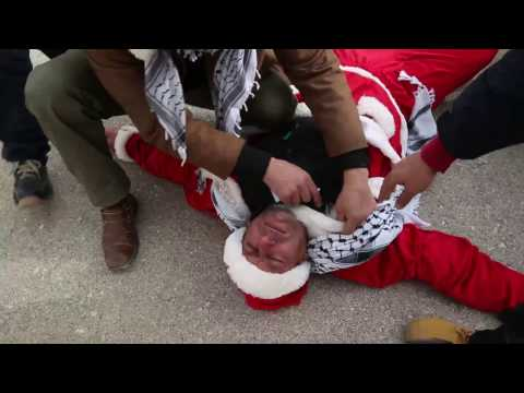Israeli soldiers tear gas Santa