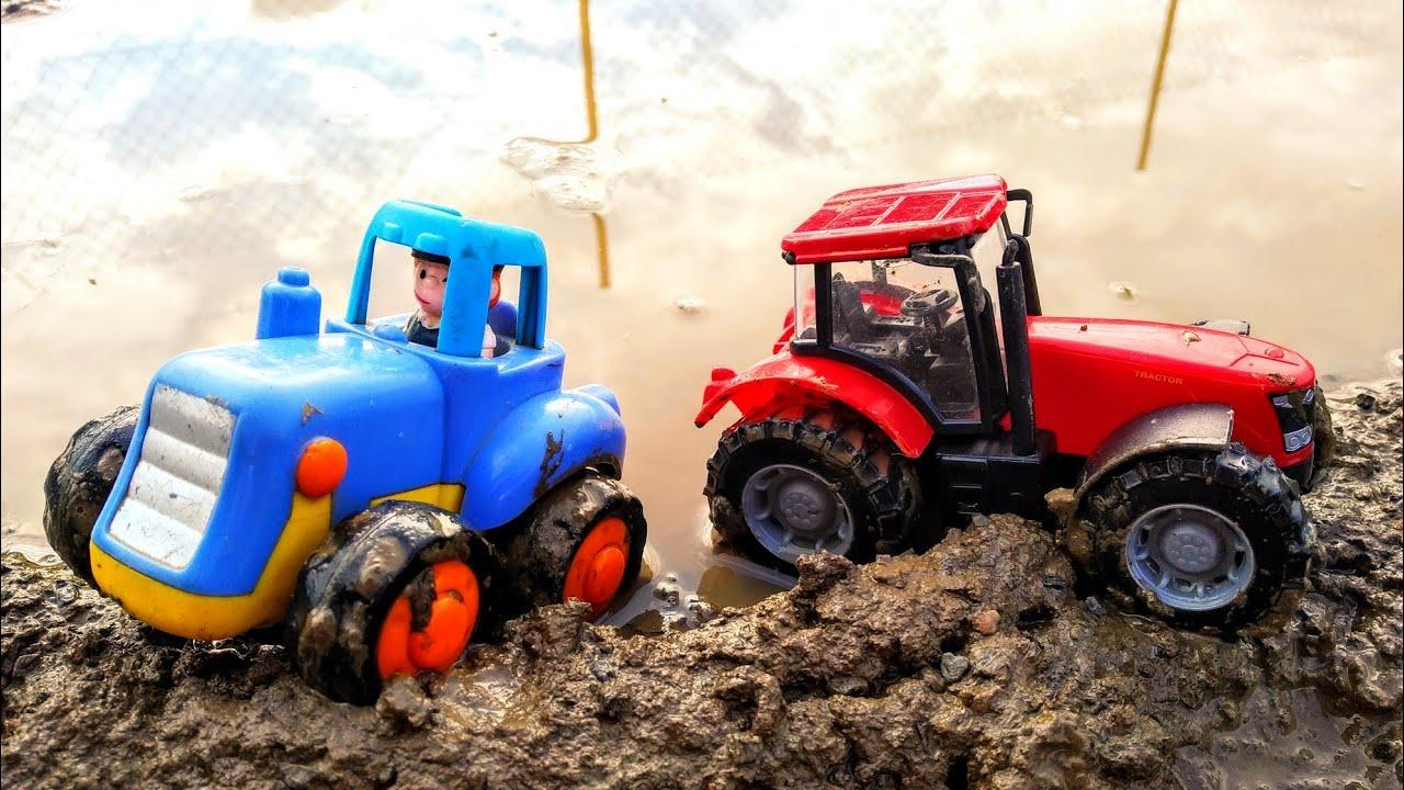 Мультики про машинки. Синий трактор едет по лужам, по ...
