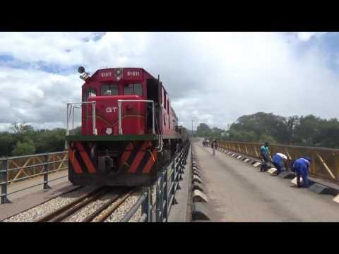 Train of fuel tankers crossing Vic  Falls bridge