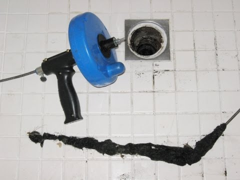 Home maintenance clogged shower drain plumber auger by froggy snake