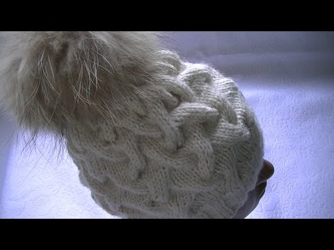 "Hand-knitting of a hat with a pattern ""Braids with shadow"""