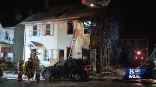 Barking dog alerts family to row home fire, homeowner says