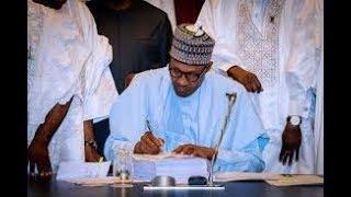 nigeria news:president muhammadu buhari sign 2018 budget for nigerians