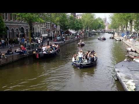 Busy Amsterdam canal - visiting Holland (The Netherlands)