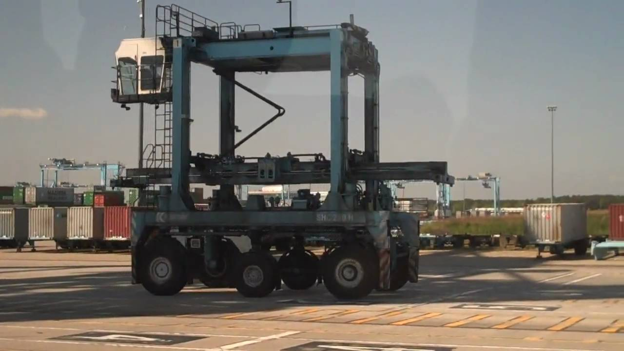 40ft Shipping Container >> Shipping Container Straddle Carrier Fork Lift - YouTube