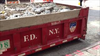 RARELY SEEN FDNY HOOK LIFT ROLL OFF DUMP TRUCK NEAR W. 49TH ST. & 8TH AVE. IN MIDTOWN, MANHATTAN.
